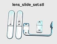 Name: lens_slide_set_500.jpg Views: 151 Size: 33.1 KB Description: Qty 5 M3 brass insert are installed on this part.  This slide assembly is locked in place by the lens adj screw cap.  If you want to have the lens adjustment on the left side then mirror print all these parts.