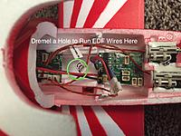Name: 3. Center Hole Channel to Run EDF Wires Through Fuselage.jpg Views: 171 Size: 1.18 MB Description: The UMX F-16 Receiver Board is glued in using GE Type II Silicone.  Dremel a channel hole in the indicated section through the bottom of the fuselage.  The EDF Wires will be channeled through that hole where it can attach to the UMX F-16 Receiver Board.