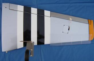 Bottom of wing showing aileron servo, wing droops, and gear. Wing panels are on an aluminum joiner and lock with a nylon strap.