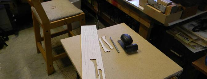 The little able next to my work bench is handy for several things. Here I use it for sanding each sheet.