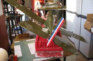 The lower wing is bolted on in order to accurately align the tail surfaces.