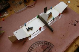I built simple jigs to hold the tail parts while the glue dried.