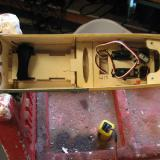 The plywood part with the elongated oval hole is a mount for the receiver.