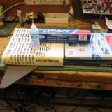 Here the left and right wing decks and the nose deck are glued and setting up. Wax paper beneath the parts and between them and the books keeps things from sticking where they shouldn't. Two heavy books are mandatory (but they don't have to be d