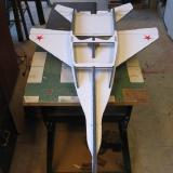 The hatch frame is attached to the lower fuselage sides.