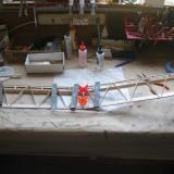 """Glue the wing halves together. One half is blocked up 4 1/8"""" to set the dihedral angle."""