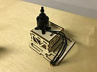 Name: 29.JPG Views: 33 Size: 2.08 MB Description: Next, fit the motor onto the motor box like shown. Mark the wholes of the mount with a marker to indicate where to drill the holes.