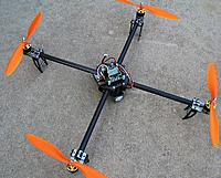 Name: quad-02.jpg Views: 276 Size: 294.7 KB Description: I built this one for my friend Michael.  But one of the prop adapters broke and it crashed.