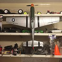 Name: P51D Mustang 2015-11-27 001.jpg Views: 107 Size: 370.4 KB Description: P51D Mustang. My son loved Planes, too. This one I was able to get a full top view.  There is also a Hobbico Nextar ARF .46 Trainer & I have two Flight Simulators. This plane is on a stand and the wings are on a rack.
