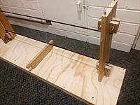 Name: Jig2b Upright 1.jpg Views: 98 Size: 167.0 KB Description: You can flip the wing over or stand it on either end, and those dowels you can see plug into holes in the base. That piece in the middle is just some scrap the same height as the rods, to stop them sagging. They WILL sag without it