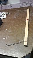 """Name: Bow.jpg Views: 70 Size: 436.2 KB Description: I drilled & tapped the workbench top for the bow. That holds the wire about 1/4"""" off the bench, so I then pull the core blank through the wire.   Red Velcro is to hold power lines in place when cutting."""