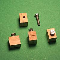 Name: Jig blocks1.jpg Views: 13 Size: 56.9 KB Description: Simple wooden blocks, tapped for flat-headed bolts.