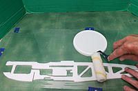 Name: 5 Gluing laminations.JPG Views: 15 Size: 1.22 MB Description: Cool Whip lid made for a good glue pan, whilst a cheap roller was good for applying the glue (without tearing the foam).
