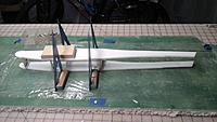 Name: Fuse sides joined.jpg Views: 250 Size: 623.5 KB Description: Bulkheads have been glued in, let dry, then the fuse sides are joined at the wing LE and TE.