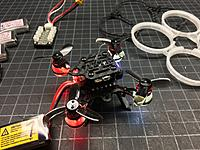 Name: IMG_1385.JPG Views: 18 Size: 2.74 MB Description: I like making my build light up.  There are lights top and bottom of all motor pods, and front and rear RGB LEDs controlled by Betaflight.  The motor pod LED housing are done in TPU so they double as soft motor mounts