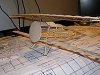 Name: P2250043.jpg Views: 79 Size: 781.6 KB Description: Added the final pieces of sheeting to the top of the fuse as well as the landing gear.