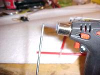 Name: MVC-RW70.jpg Views: 2957 Size: 23.8 KB Description: Heat up a screwdriver.