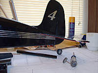 Name: HPIM0954.jpg Views: 74 Size: 59.3 KB Description: #4 on rudder and a good shot of the matching tail wheel