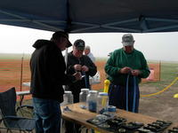 Name: DSCN7315.jpg Views: 238 Size: 78.0 KB Description: Every year we set up a pop up tarp and bring tables to put out the prizes...and we start getting pilots signed up.  We have raffles for three nice items (Plane, motor, pop up tarp) and we've got a pilot's drawing for a DX7 radio.  The raffles al