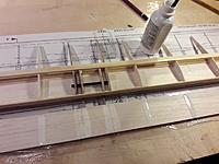 Name: 20190312_181504.jpg Views: 13 Size: 140.2 KB Description: Painted glue (thinned with water) on the ribs and inner side of the balsa sheet.