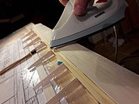 Name: 20190313_205900.jpg Views: 14 Size: 103.2 KB Description: ... ironed it half way down, shaped it to fit perfect to the spar and put some glue in the gap between balsa and spar  .....