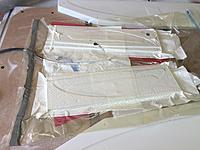 Name: ashoriz06.jpg Views: 264 Size: 82.1 KB Description: Then in the bag.   I soaked up epoxy with paper towels each layer I put down, hoping to leave behind as little as possible.   Then some peal ply and then perf, then paper towels...