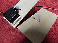 Name: DSCN1398.jpg Views: 57 Size: 215.7 KB Description: Servos attached with dry canopy glue and bordered with 1/8 sq. balsa.
