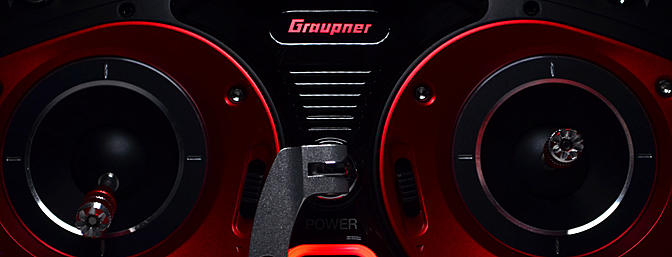 The Graupner logo and power button glow red. The logo changes to blue when transmitting RF.
