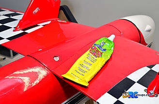 Quick Grip is a great all-purpose silicon based glue that works perfectly for attaching plastic parts to your plane.