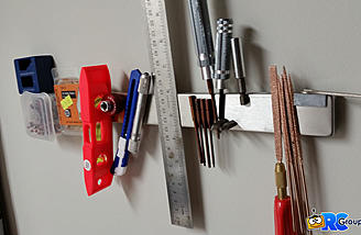 Wall mounted magnet bars are another great thing to keep your workbench cleaner!