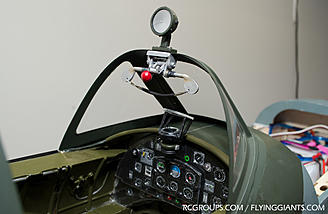 The cockpit latch, rear-view mirror mounted and instrument panel background repainted.