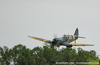 The 1/4 scale Spitfire on a zoom and boom pass.