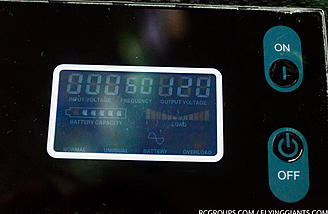 A LCD panel shows battery stats.