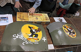 A pair of hand-painted C-47 engine cowling pieces with accurate nose-art from a P-51 and Spitfire flown by one pilot.