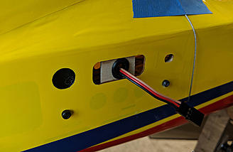 I added a rubber grommet in some scrap wood to prevent the elevator wires from falling into the fuselage.