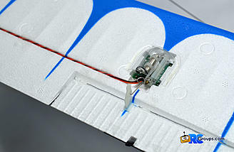 Linear servos under the wing power the ailerons.