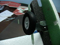 Name: IMG_1021.jpg Views: 745 Size: 123.1 KB Description: Now install the wheel bolts, and if you are going to use the wheel pants, install the fiberglass wheel pant mount shown here