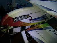 Name: IMG_1273.jpg Views: 374 Size: 157.6 KB Description: Here is the cut done and the battery installed, as you can see with a 2200 11.1V pack, in this position the CG is at the farthest AFT of the range, so definately take into consideration this before cutting it.  Also after this install the Landing Gear Foa