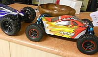 Name: Red fake rim lock wheels on brushless.jpg Views: 50 Size: 235.1 KB Description: