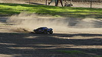 Name: Jeff4.JPG Views: 10 Size: 5.09 MB Description: Jeff kicking up some dust with his Slash Ult 4x4