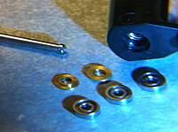 Name: bearings3.jpg Views: 352 Size: 75.1 KB Description: Bearings and blade grips.
