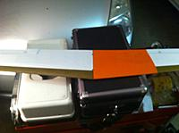 Name: Speedo Wing gets a bandaid 2.jpg Views: 63 Size: 96.7 KB Description: Bird of Time orange...  I like the color and when I have more time then just a quick fix I will be recovering the entire wing in some pattern of orange and something else.