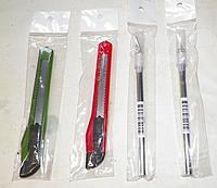 Name: knives01.jpg Views: 114 Size: 90.8 KB Description: Cheap Plastic Knives and Exacto clone knives.