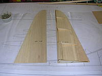 Name: DSCN4364.jpg Views: 263 Size: 159.1 KB Description: One side of sheeting glued up to the internal structure.  Note additional balsa blocking at lower end at the LE.