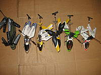 Name: IMG_1381.jpg Views: 864 Size: 83.5 KB Description: Group shot with my other Sub-Micro 3 channel IR controlled gyro equipped birds...from L to R Syma S026G, Syma S105G, Syma S107, 9808, San Huan 6020-1 Phantom 6010