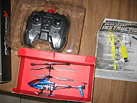 Name: IMG_1745.jpg Views: 106 Size: 121.6 KB Description: Contents of the package, Heli, TX, USB charger, manual, spare tail rotor.
