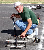 Name: daded.jpg Views: 11 Size: 340.5 KB Description: My dad flying his Pulse Jet.   Engine pictured below is not this engine. Just wanted to include a pic of my dad :)