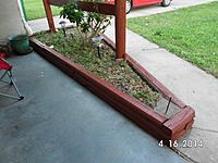 Name: SANY1089.jpg Views: 118 Size: 887.4 KB Description: Odd shaped flower bed. Looks like it is time to weed the beds too. I wonder what the going rate is for that?
