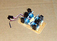 Name: SERVO_MNT3.jpg Views: 114 Size: 79.0 KB Description: 4 control servos mounted on 1 2x3 inch board. Total of 8 functions