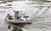 Name: RUNa_091210.jpg Views: 158 Size: 100.3 KB Description: Sits nice in the water.